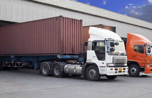 truck-container-ship-parked-warehouse-distribution_36860-327